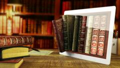 old books in a digital library -  in the tablet - stock footage