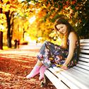 Stock Photo of girl on a bench