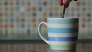 Stock Video Footage of Stirring a cup of tea