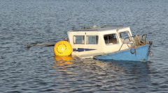 Sunk blue fishing boat and mooring bouy Stock Footage