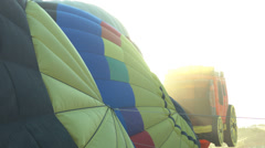 Sun rays shine around hot air balloons Stock Footage