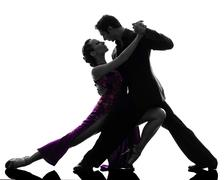 Couple man woman ballroom dancers tangoing  silhouette Stock Photos