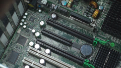 Man Inserts A Video Convertor Board From A Work Station Stock Footage