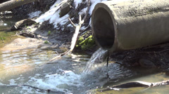 Pipe into the drainage hole through which sewage flows - stock footage
