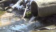 Stock Video Footage of Pipe into the drainage hole through which sewage flows