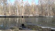 Stock Video Footage of Frozen dirty lake is beginning to thaw