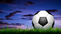3d football in green grass over a twilight sky - stock illustration