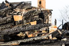 Ruins and remains of a burned down house Stock Photos