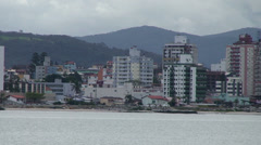 044 Florianopolis, skyline Beira-Mar avenue, old ship passing by - stock footage