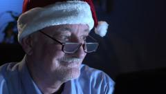 Man in Santa hat Christmas shopping online Stock Footage