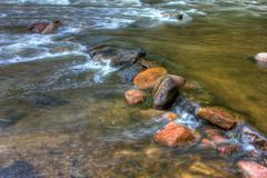 hdr of river rapids. - stock photo
