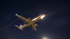Jet airplane approaching landing at night in Los Angeles LAX airport. Stock Footage