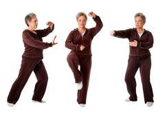 Senior woman doing Tai Chi Yoga exercise - stock photo