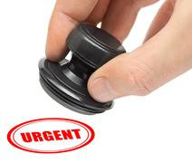 Hand and stamp Urgent Stock Photos