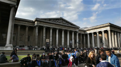 Tourists in front of the British Museum's main entrance in London Stock Footage