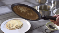 Stock video Footage tossed pancake in a frying pan - stock footage