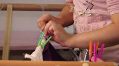 Montessori, child hanging clothes 2 Stock Footage