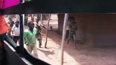 0882 Childern in Africa Running after Car and say Goodbye - stock footage