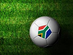 south africa flag pattern 3d rendering of a soccer ball in green grass - stock illustration