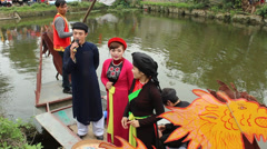 Asian group singing folk songs in folk festival Stock Footage