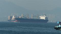 Time Lapse  Yang Ming ocean liner passing Hong Kong to China Asia Stock Footage