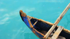 A fishing canoe peacefully floating on the tropical sea of Bali Stock Footage