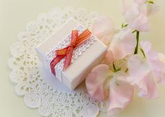 Pink sweet peas and a gift box - stock photo