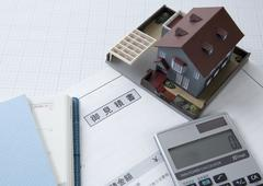 Estimate, an architectural model and a calculator Stock Photos
