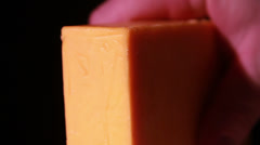 Stock Video Footage of Cheddar Cheese being Cut