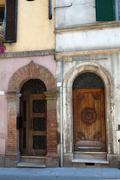 Wooden residential doorway  in tuscany. italy Stock Photos