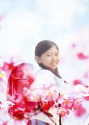 Girl carrying a school bag and cherry blossoms Stock Illustration