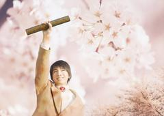 Junior high school boy holding a diploma tube and cherry blossoms - stock illustration