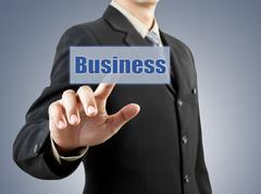 Businessman hand pushing business button Stock Illustration