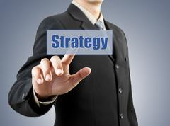 Businessman hand pushing strategy button Stock Illustration