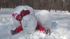 Child Playing with Snowman Head in Park, Little Girl in Snow, Winter Games Stock Footage