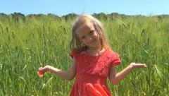 Smiling Child Playing with Poppy Flower on Wheat Field, Girl in Nature, Children Stock Footage