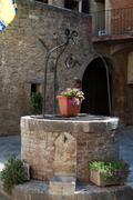 The stony well in asciano, tuscany Stock Photos