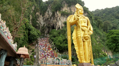 Batu caves timelapse with murugan statue and stairs Stock Footage