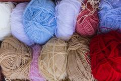 Balls of wool multi colored yarns Stock Photos