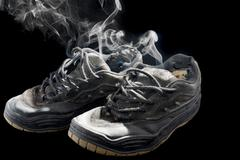 Rotten old sneakers Stock Photos