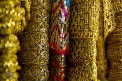 Gold braid cloth material Stock Photos