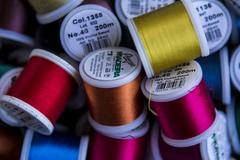 A background collection Cotton and Nylon thread reels - stock photo
