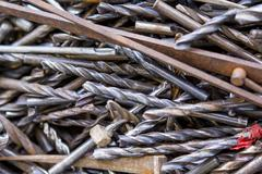 A collection of metal machine drill bits Stock Photos