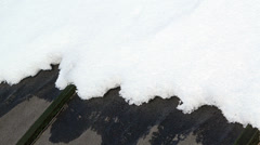 On a black roof snow melts. Time Lapse. 4K Stock Footage