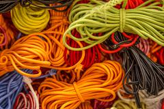 Fluorescent orange and yellow string cords Stock Photos