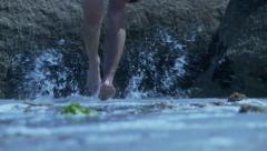 Ancient marathon runner running through water Stock Footage