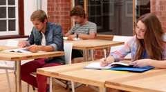 Students sitting in classroom studying Stock Footage