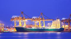 Stock Photo of logistic concept, container cargo ship transport import export in harbor and