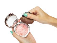 cosmetic brush and hand - stock photo