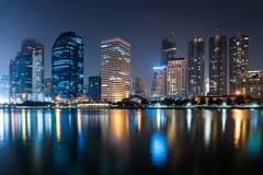 Bangkok city downtown at night with reflection of skyline, bangkok,thailand Stock Photos